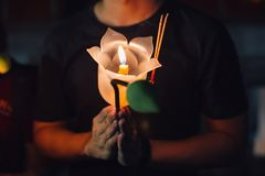 Buddhist praying with incense sticks, lotus flower and candles on holy religion day of Vesak at night. Buddhist praying with incense sticks, lotus flower and stock photography