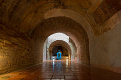Buddhist praying in old temple. Buddhist praying in old tunnel of Umong temple royalty free stock photo