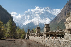 Buddhist praying wall in Landscape in Annapurna circuit. Trekking in Nepal stock photography