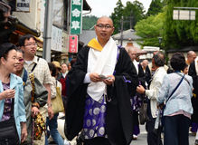 Buddhist priest distributing good luck charms during Aoba festival Stock Photos