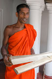 Buddhist priest with holy scriptures Royalty Free Stock Photos