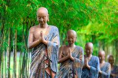 Buddhist priest's statue stock images