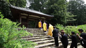 Buddhist priests and believers. KAGAWA, JAPAN - MAY 17 : Buddhist priests and believers walk to Hagiwara-temple as they prepare for a traditional praying ritual stock footage