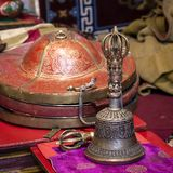 Buddhist religious equipment - Vajra Dorje and bell in tibetan monastery. Ladakh, Jammu Kashmir, India. Close up royalty free stock photo