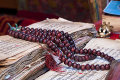 Buddhist religious japa mala on manuscript Stock Image