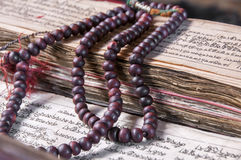 Buddhist religious japa mala on manuscript. Vajra Dorje and bell stock photos