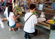 Buddhist religious people praying at the temple from Damnoen Saduak Floating Market, Thailand Royalty Free Stock Image
