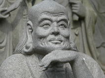 Buddhist religious sculpture. Stone face of japanese religious sculpture near the temple in Kyoto, Japan Stock Image