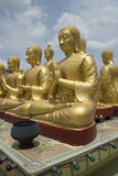Buddhist`s Disciple statue. And Big Buddha statue Stock Photo