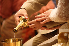 Buddhist's grail pouring water Stock Photo