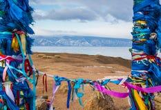 Buddhist sacred place at frozen lake Baikal on mountains backgro Stock Image