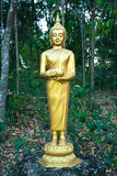 Buddhist Sculpture - Buddha Holding an Alms Bowl Stock Photo