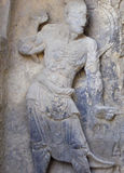 A Buddhist Sculpture inside stone cave Stock Images