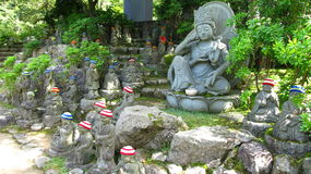 Buddhist sculptures. Buddhist jizo sculptures in Daishō-in temple on Miyajima Icland , Japan. Hats on the small statues heads are put by a woman who lost or royalty free stock photos