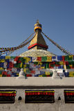 Buddhist Shrine Boudhanath Stupa with pray flags over blue sky. Royalty Free Stock Photography