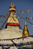 Buddhist Shrine Boudhanath Stupa with pray flags over blue sky. Royalty Free Stock Image