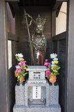 Buddhist shrine with buddha statue with crown and pilgrims staff as a symbol for power. Kumamoto, Japan - November 13, 2018: Buddhist shrine with buddha statue stock photo
