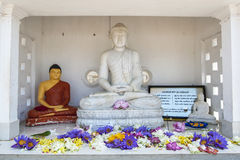 A Buddhist shrine built at the base of the magnificent Ruwanwelisiya Dagoba in Sri Lanka. Royalty Free Stock Image