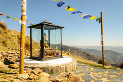 Buddhist shrine at O Sel Ling in Alpujarra, Spain. Buddhist shrine with prayer flags at O Sel Ling, a Tibetan monastery retreat in the mountains in Alpujarra Royalty Free Stock Photo