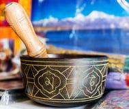 Buddhist singing bowl vase. Buddhist singing bowl metall  vases group on red cloth Stock Photo
