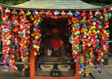 Buddhist sitting in decorated hut in Gion district Japan. Royalty Free Stock Images