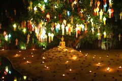 The Buddhist with small fire lamp  and paper lanterns formed in loykratong festival at Wat Phan Tao in Chiang Mai - Thailand Royalty Free Stock Images