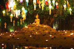 The Buddhist with small fire lamp  and paper lanterns formed in loykratong festival at Wat Phan Tao in Chiang Mai - Thailand Royalty Free Stock Image