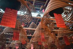 Buddhist spiral scented sticks in the Man Mo Temple in Hong Kong China royalty free stock image