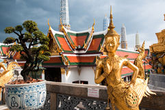 Buddhist Statue. At the Temple of the Emerald Buddha, Bangkok, Thailand Royalty Free Stock Photos