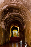 Buddhist statue. In antique tunnel Royalty Free Stock Photo