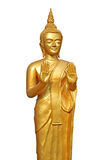 Buddhist Statue. A golden buddhist statue isolated on a white background Royalty Free Stock Photo