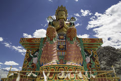 Buddhist statue against Himalayas Stock Image