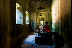 Buddhist statue in Angkor. Buddhist statue in a long, dark corridor Stock Photo