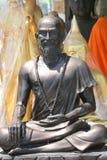 Buddhist statue, Bangkok, Thailand. Buddhist elderly man monk statue, Bangkok, Thailand Stock Image