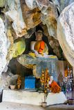 Buddhist statue in a cave, Vang Vieng stock image