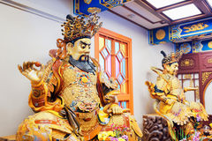 Buddhist statue at the entrance to the Po Lin Monastery Stock Image