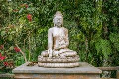 Buddhist Statue in a Garden. Located in buddhist temple where garden full of statue stock photo