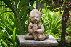 Buddhist statue in garden. Thailand Royalty Free Stock Photography