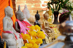 Buddhist statue with garland. Royalty Free Stock Images