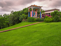 Buddhist statue. With grass and trees and rain clouds - City of Gramado - Brazil Stock Images