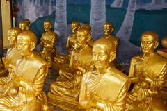 Buddhist statue. Group of monk statue praying Royalty Free Stock Photos