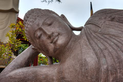 Buddhist statue head and shoulders Stock Photos