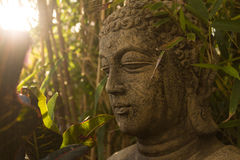 Buddhist statue in nature - garden decoration Stock Image