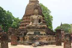 Buddhist statue. Old buddhist statue on old pagoda background Stock Images