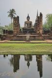 Buddhist statue. Old buddhist statue on water reflect royalty free stock image