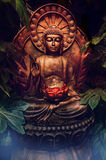Buddhist statue. Photo of glowing Buddhist statue in mystical setting Royalty Free Stock Photography