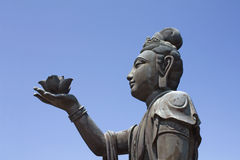 Buddhist statue providing offerings Stock Image