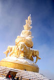 Buddhist statue with snow  Royalty Free Stock Photos
