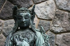 Buddhist Statue stone wall background, Tokyo Royalty Free Stock Photo