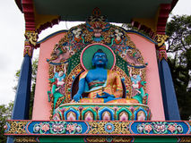 Buddhist statue. With trees and rain clouds - City of Gramado - Brazil Royalty Free Stock Photo